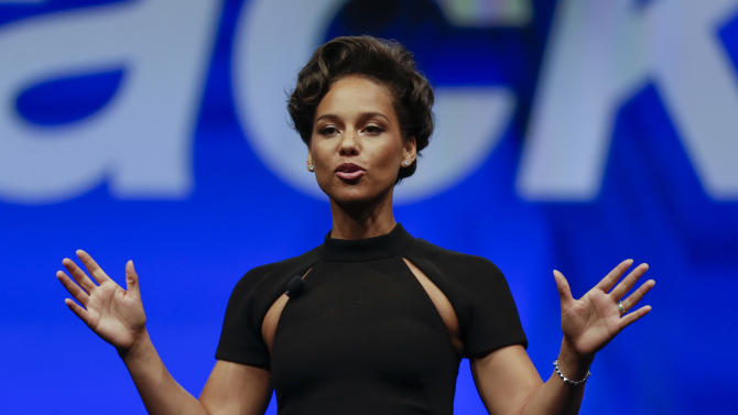 Entertainer Alicia Keys, Global Creative Director for BlackBerry speaks at Research In Motion's annual conference, Tuesday, May 14, 2013, in Orlando, Fa. RIM unveiled a lower-cost BlackBerry aimed at consumers in emerging markets, stepping up its efforts to regain market share lost to Apple's iPhone and Android devices powered by Google's software.(AP Photo/John Raoux)