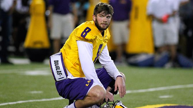 LSU quarterback Zach Mettenberger pauses during NFL football pro day, Wednesday, April 9, 2014, in Baton Rouge, La. (AP Photo/Jonathan Bachman)