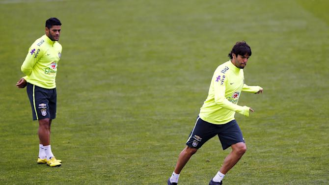 Brazil's player Kaka prepares to kick a ball as Hulk looks on during a team training session at Santiago
