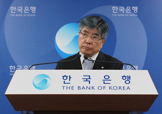 Kim Choong-soo, governor of the Bank of Korea, listens to a reporter's question during a press conference as Kim announce the benchmark call rate at the headquarters of the Bank of Korea in Seoul, South Korea, Friday, Jan. 11, 2013. South Korea's central bank cut its forecast for the country's economic growth this year due to slower corporate investment and uncertainties about the global economy. (AP Photo/Ahn Young-joon)