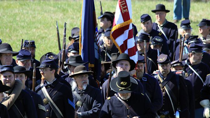 In this April 11, 2015 photo, Union Army Civil War re-enactors march onto the battlefield at the 150th anniversary re-enactment of the Battle of Appomattox Court House in Appomattox, Va. Region men were among the participants in one of the war's final battles, including men from Lake, Porter and LaPorte counties serving in the 20th Indiana Infantry. A journal from Major Erasmus Gilbreath, an officer from the regiment, is being released in a new published volume, together with the opening of a Chicago museum exhibit dedicated to Gilbreath and his 37-year military career. (Marc Chase/The Times of Northwest Indiana via AP)