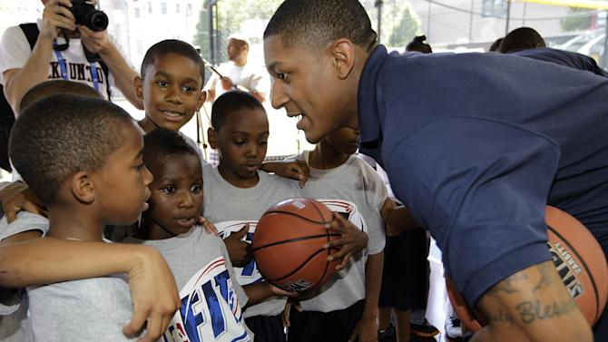NBA Draft prospect Bradley Beal, right, talks to youngsters during an NBA fitness clinic at the Children's Aid Society Dunlevy Milbank Boys & Girls Club in the Harlem section of New York, Wednesday, June 27, 2012. (AP Photo/Kathy Willens)