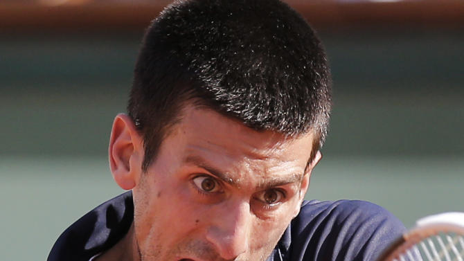 Novak Djokovic of Serbia returns in his semi final match against Roger Federer of Switzerland at the French Open tennis tournament in Roland Garros stadium in Paris, Friday June 8, 2012. Djokovic won in three sets 6-4, 7-5, 6-3. (AP Photo/Michel Euler)