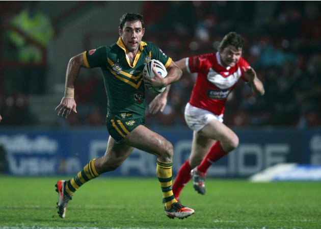 Australia's Cameron Smith, left, is chased by Wales' Lee Briers during their four nations rugby league test match at the Racecourse Ground, Wrexham, Wales, Sunday Nov. 13, 2011. (AP Photo/Tim Hales)