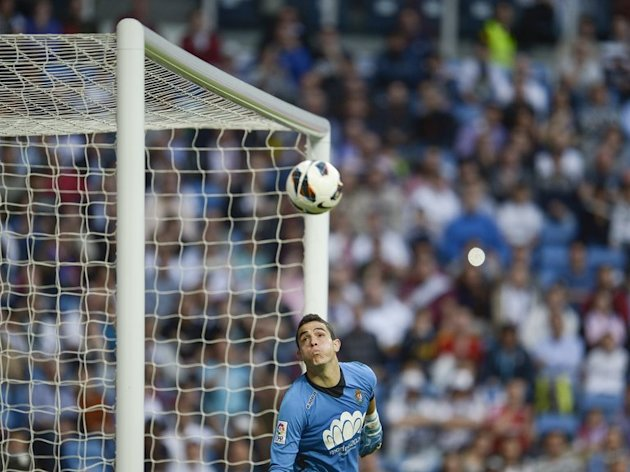 Valladolid's goalkeeper Jaime Jimenez eyes the ball during their match at Real Madrid, on May 4, 2013