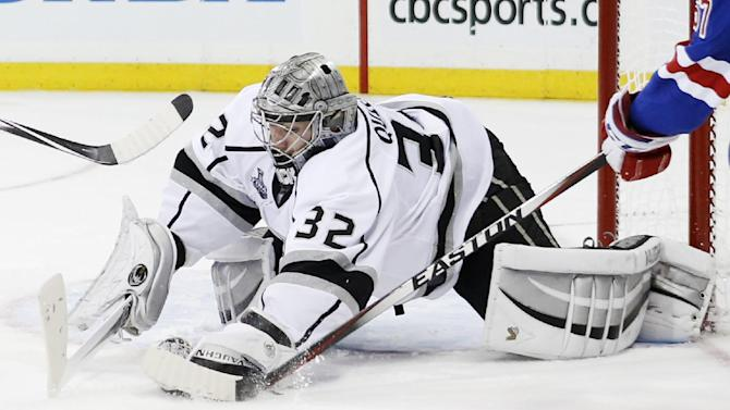 Los Angeles Kings goalie Jonathan Quick (32) blocks a shot against the New York Rangers in the second period during Game 3 of the NHL hockey Stanley Cup Final, Monday, June 9, 2014, in New York