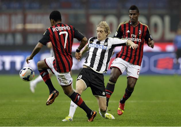 Udinese's Dusan Basta of Serbia, center, challenges AC Milan's Robinho, left, during a Serie A soccer match between AC Milan and Udinese, at the San Siro stadium in Milan, Italy, Saturday, Oct. 19, 20