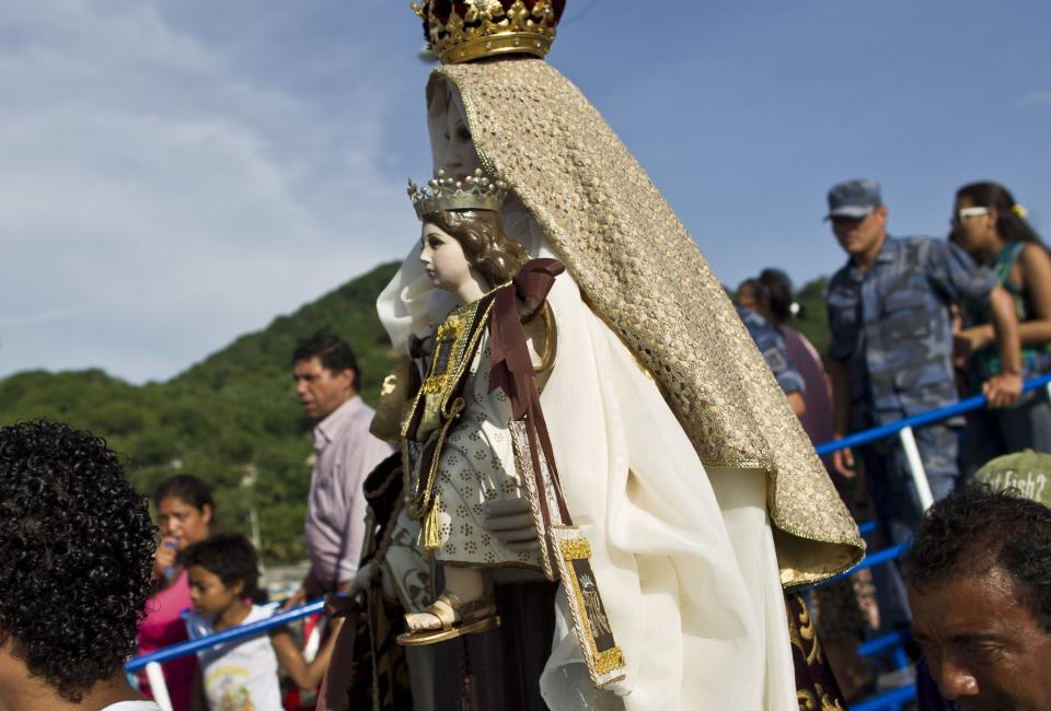 A statue of the Virgin of Carmen is carried to the start of a procession at the port of San Juan del Sur, Nicaragua, Tuesday, July 16, 2013. Nicaragua's fishing community celebrated the feast day of the Virgin de Carmen who is worshipped by Catholics as the patron saint of fishermen and sailors. (AP Photo/Esteban Felix)