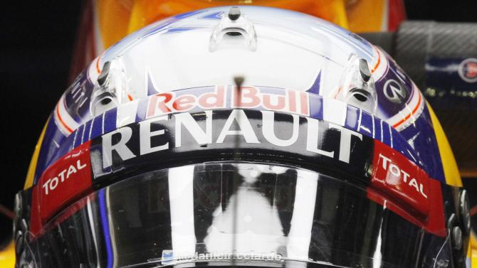 Ricciardo wipes his eyes during the third practice session of the Singapore F1 Grand Prix at the Marina Bay street circuit in Singapore