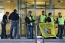 Greenpeace activists block the entrance to the headquarters of Shell in the Hague