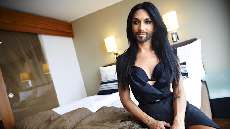 Austrian singer and Eurovision Song Contest 2014 winner Conchita Wurst (Thomas Neuwirth) poses for a photograph during a news interview at a hotel in Stockholm, Sweden, on Wednesday, July 30, 2014. Wurst is in Sweden to perform during the inauguration of the annual Stockholm Pride Week later tonight. (AP Photo/TT/Fredrik Persson)