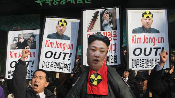 A South Korean protester shouts slogans near an effigy of North Korean leader Kim Jong Un during an anti-North Korea rally to denounce North Korea's nuclear test in Seoul, South Korea, Wednesday, Feb. 13, 2013. A day after North Korea defied U.N. warnings with a nuclear test, Pyongyang's neighbors turned Wednesday to the business of bolstering their military preparations and sending out scientists to determine whether the detonation was as successful as the North claimed.(AP Photo/Ahn Young-joon)