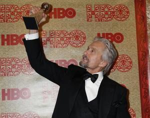 "Actor Douglas holds the Golden Globe Award he won as Best Actor, Miniseries or Movie, for his role in HBO's ""Behind the Candelabra"" at the HBO after party, after the 71st annual Golden Globe Awards in Beverly Hills"