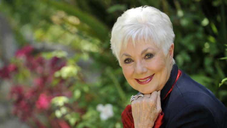 """FILE - In this July 15, 2013 file photo, actress Shirley Jones poses for a portrait at her home in Los Angeles. Jones is celebrating her 80th birthday on the ground, instead of skydiving as she had planned. A spokesman for """"The Partridge Family"""" actress said Monday, March 31, 2014, that Jones agreed to postpone the jump after her sons and grandchildren asked her to reconsider. (Photo by Chris Pizzello/Invision/AP, File)"""