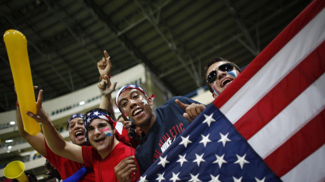 U.S. fans celebrate during a 2014 World Cup qualifying soccer match between U.S. and Antigua and Barbuda in St. John, Antigua and Barbuda, Friday, Oct. 12, 2012. U.S. won 2-1. (AP Photo/Ricardo Arduengo)