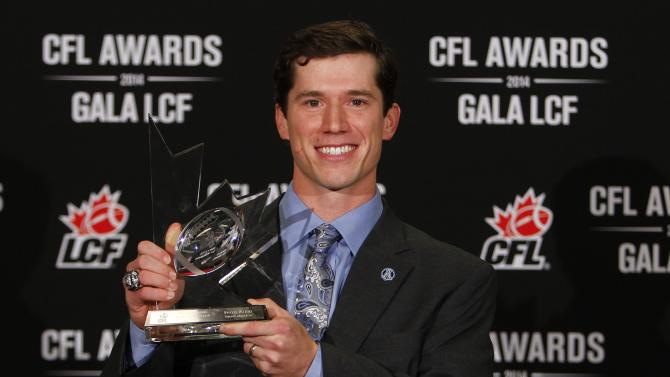 Toronto Argonauts' Waters holds his trophy for the most outstanding special teams player during CFL awards at the CFL's 102nd Grey Cup week in Vancouver.