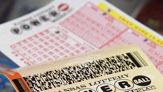 FILE - In this Friday, Nov. 23, 2012 file photo, a Powerball form and purchased ticket are on the counter at the Jayhawk Food Mart in Lawrence, Kan. A single ticket sold in New Jersey matched all six numbers in the Saturday night, March 23, 2013 drawing for the $338.3 million Powerball jackpot, lottery officials said. (AP Photo/Orlin Wagner, File)