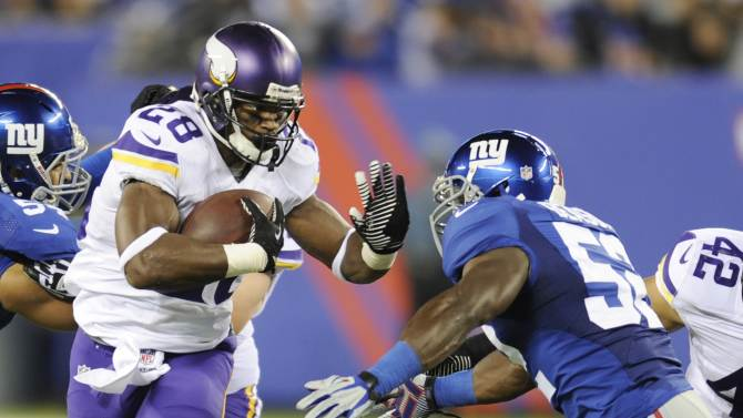 Vikings' Peterson aims for revival vs. Packers