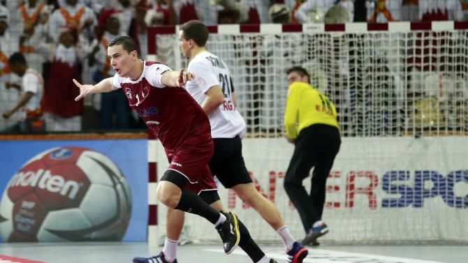 Markovic of Qatar celebrates after scoring against Germany during their quarterfinal match of the 24th Men's Handball World Championship in Doha