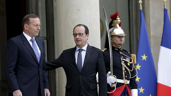 French President Hollande welcomes Australian PM Abbott at the Elysee palace in Paris