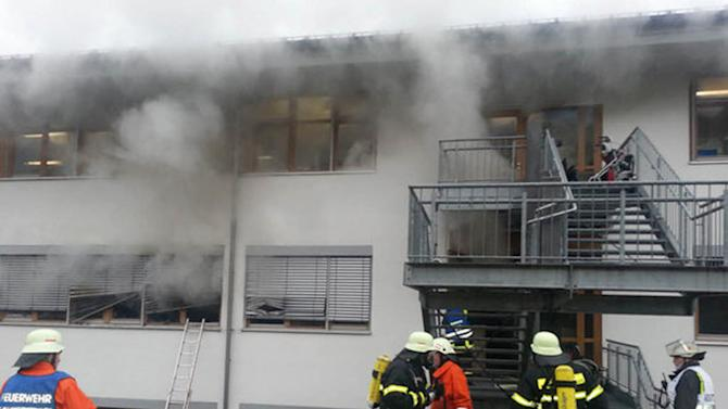 In this image taken from video firefighters try to extinguish flames in a workshop for disabled people in Titisee-Neustadt, southwestern Germany, Monday, Nov. 26, 2012. Firefighters said the fire has killed 14 and injured at least six others. There was no immediate information on why the building in Titisee-Neustadt, near the city of Freiburg, caught fire Monday. (AP Photo/dapd, Kamera24.TV)