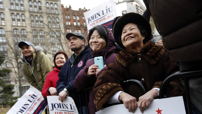 Supporters look on as New York City Comptroller John Liu greets them after announcing the launch of his mayoral campaign on the steps of City Hall, Sunday, March 17, 2013 in New York.  Already the first person of Asian descent to be elected citywide in New York, Liu hopes to become the city's first Asian-American mayor. (AP Photo/Jason DeCrow)