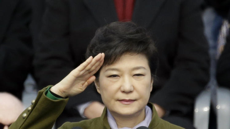 South Korea's new President Park Geun-hye salutes during the 18th presidential inauguration ceremony at the National Assembly in Seoul, South Korea, Monday, Feb. 25, 2013. Park  became South Korea's first female president Monday, returning to the presidential mansion where she grew up with her dictator father.  (AP Photo/Lee Jin-man)