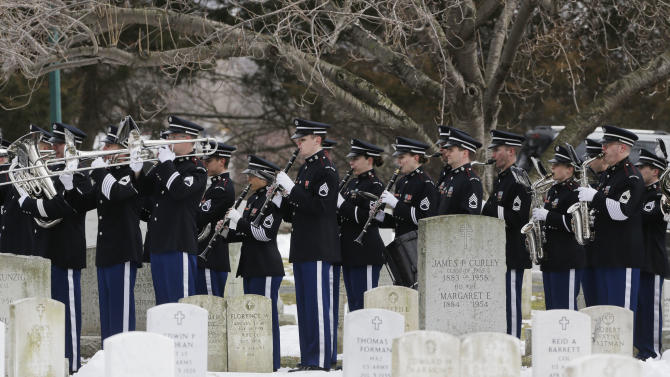 The U.S. Military Academy Band performs during a burial service at the West Point Cemetery on Friday, March 22, 2013, in West Point, N.Y. The service was for Maj. Gen. Robert Strong and wife Virginia Strong. Graves of soldiers from every U.S. war make this small plot of the land the most hallowed ground on the nation's the most venerable military academy. And after 196 years and more than 8,000 souls, it's close to full. (AP Photo/Mike Groll)