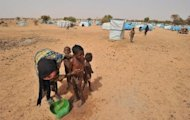 A woman is seen washing her children at Mangaize's refugee camp, 145 km north of Niamey, where refugees from northern Mali have found shelter