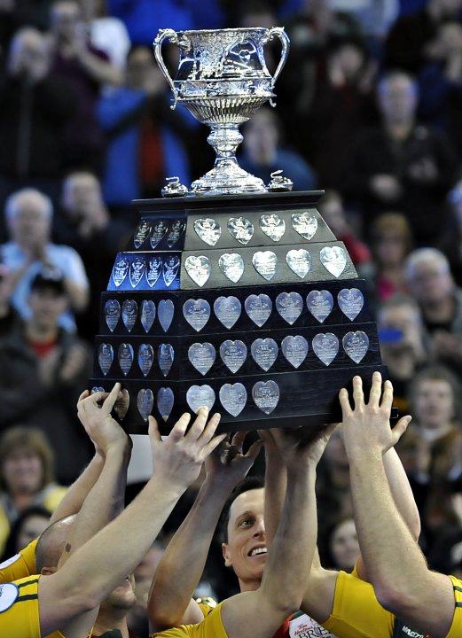 Members of Northern Ontario including E.J. Harnden hold up the trophy after winning the gold medal game over Manitoba at the Canadian Men's Curling Championships in Edmonton