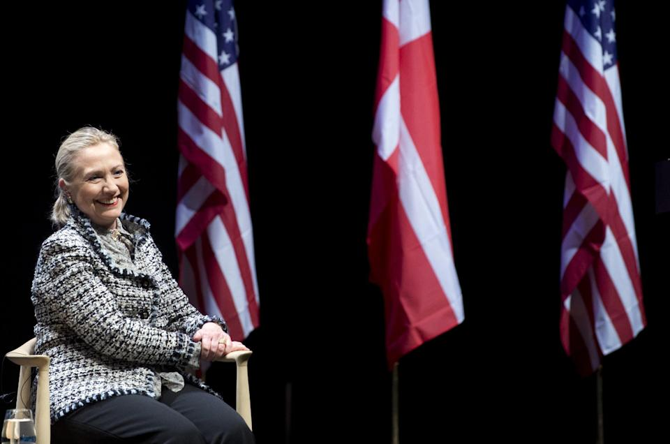 US Secretary of State Hillary Clinton smiles during a forum with students at the Royal Library in Copenhagen, Denmark, Thursday May 31, 2012. (AP Photo/Saul Loeb, Pool)
