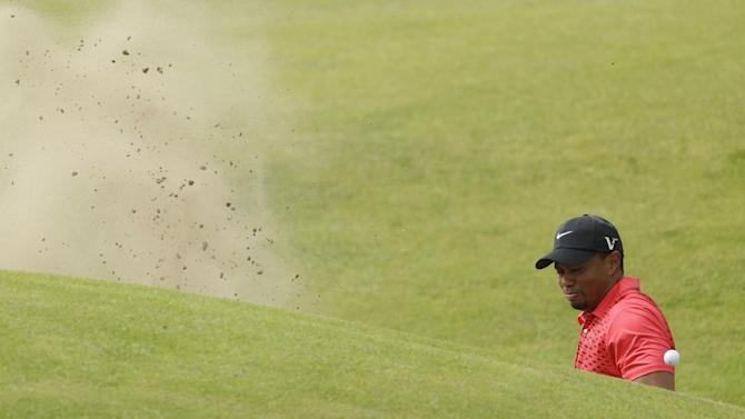 Tiger Woods of the United States fails to hit the ball out of the bunker on the sixth hole at Royal Lytham & St Annes golf club during the final round of the British Open Golf Championship, Lytham St Annes, England Sunday, July  22, 2012. (AP Photo/Peter Morrison)