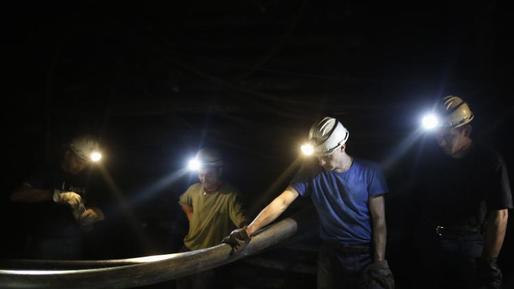 "Bosnian miners take a break inside the coal mine ""sretno"", near the central Bosnian town of Breza"
