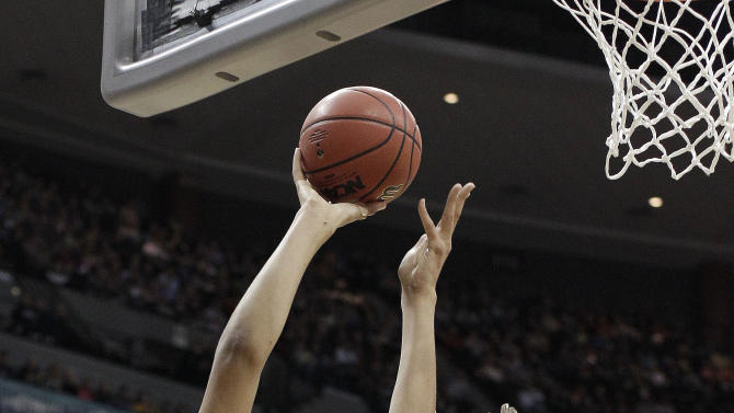 Baylor center Brittney Griner (42) shoots over Notre Dame forward Markisha Wright (34) during the first half of the NCAA women's Final Four college basketball championship game, in Denver, Tuesday, April 3, 2012.  (AP Photo/Eric Gay)