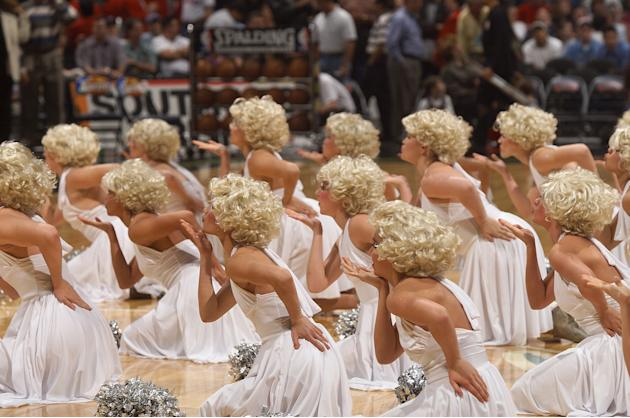 A high school dance team preforms a number dressed as multiple Marilyns in Texas