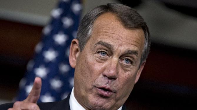 """House Speaker John Boehner of Ohio gestures during a news conference on Capitol Hill in Washington, Thursday, Dec. 13, 2012, where he accused President Barack Obama of not being serious about cutting government spending. Boehner is insisting that Obama wants far more in tax increases than spending reductions and appears willing to walk the economy """"right up to the fiscal cliff.""""   (AP Photo/J. Scott Applewhite)"""