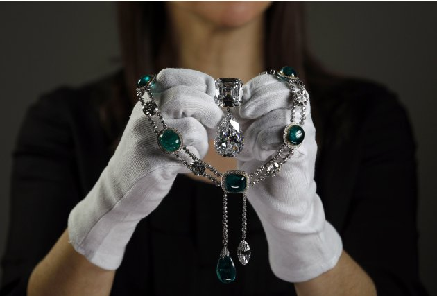 Exhibition curator Caroline de Guitaut poses with the Cullinan VII necklace at the Queen's Gallery in Buckingham Palace