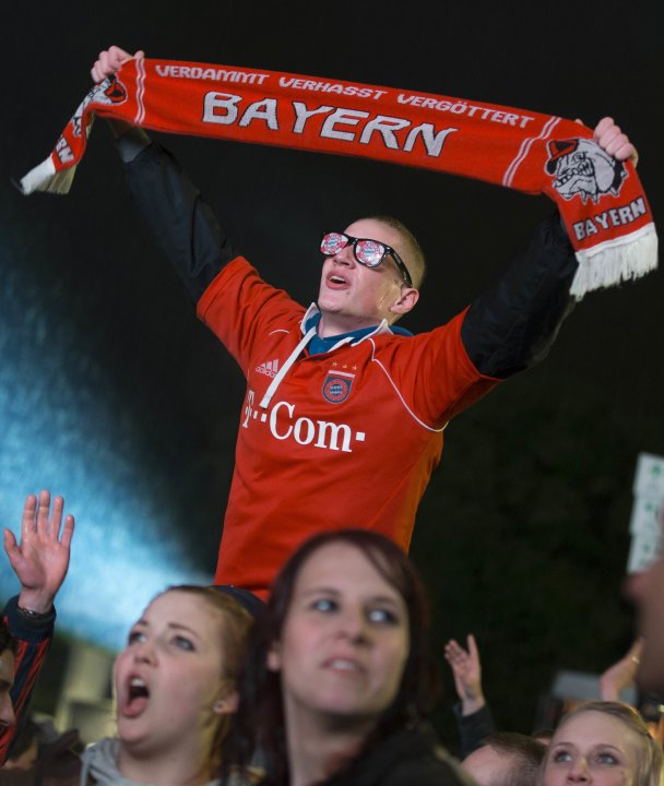 Bayern Munich supporters celebrate after watching Champions League Final soccer match at Brandenburg Gate in Berlin