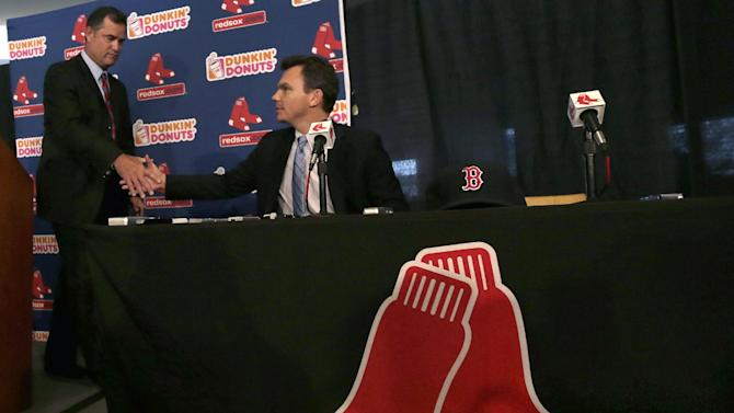 New Boston Red Sox manager John Farrell, left, shakes hands with general manager Ben Cherrington during a news conference at Fenway Park in Boston, Tuesday, Oct. 23, 2012.  Farrell becomes the 46th manager in the club's 112-year history. (AP Photo/Charles Krupa)