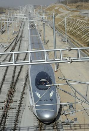 In this photo released by China's Xinhua news agency, a China Railway High-Speed (CRH) train enters Bengbu south railway station, a stop in Anhui province on the Beijing-Shanghai high-speed rail line, on Friday Dec. 3, 2010. The Chinese passenger train hit a record speed of 302 miles per hour (486 kilometers per hour) Friday during a test run of a yet-to-be opened link between Beijing and Shanghai, state media said. (AP Photo/Xinhua, Liu Junxi) NO SALES