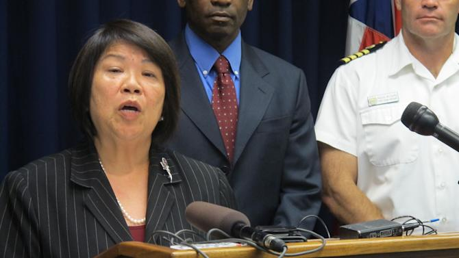 U.S. Attorney Florence Nakakuni speaks at a news conference in Honolulu on Monday, March 18, 2013 to announce authorities have charged a U.S. Pacific Command defense contractor with giving defense secrets to a Chinese woman he was romantically involved with. Benjamin Pierce Bishop, 59, allegedly sent the 27-year-old woman an email last May with information on existing war plans, nuclear weapons and U.S. relations with international partners, according to a criminal complaint filed in U.S. District Court in Honolulu. (AP Photo/Audrey McAvoy)