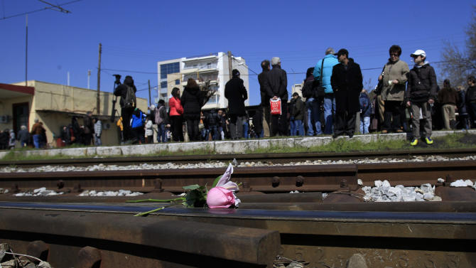 Flowers laid on the tracks   as Jewish residents in the northern Greek city  gathered at Thessaloniki's old railway station during a short ceremony  to commemorate the 70th anniversary from the first roundup and deportation of Jews to Nazi extermination camps in World War II. By August 1943, 46,091 Jews had been deported to Auschwitz-Birkenau. Of those, 1,950 survived. (AP Photo/Nikolas Giakoumidis)