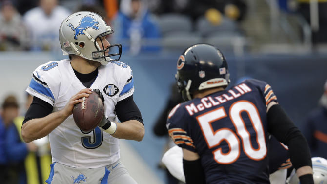 Detroit Lions quarterback Matthew Stafford (9) looks for a receiver as Chicago Bears  linebacker Shea McClellin (50) pressures him in the first half of an NFL football game Sunday, Dec. 21, 2014, in Chicago. (AP Photo/Nam Y. Huh)