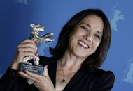 Chilean actress Paulina Garcia poses backstage with her Silver Bear award for Best Actress for the movie &quot;Gloria&quot; during the awards ceremony of the 63rd Berlinale Film Festival in Berlin on February 16, 2013