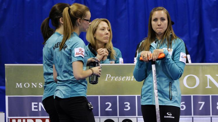 Skip Homan stands with teammates after Team Middaugh scored three in the third end during the women's semi-final at the Roar of the Rings Canadian Olympic Curling Trials in Winnipeg