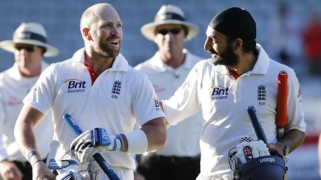 England's Matt Prior celebrates with Monty Panesar after saving the test match against New Zealand on day five of their final test at Eden Park in Auckland.