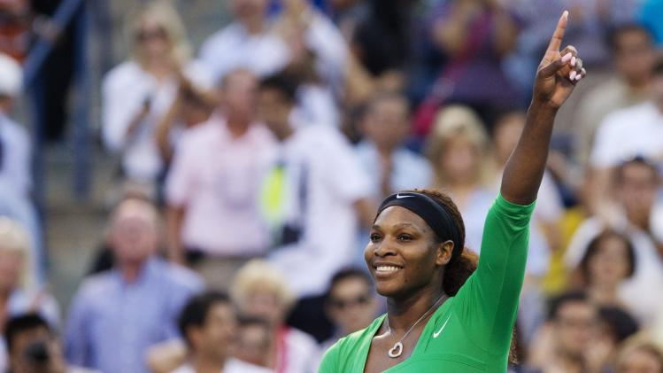 United States' Serena Williams celebrates her win over Victoria Azarenka, of Belarus, during semifinal action at the Rogers Cup women's tennis tournament in Toronto, Saturday, Aug. 13, 2011. Williams defeated Azarenka 6-3, 6-3. (AP Photo/The Canadian Press, Darren Calabrese)