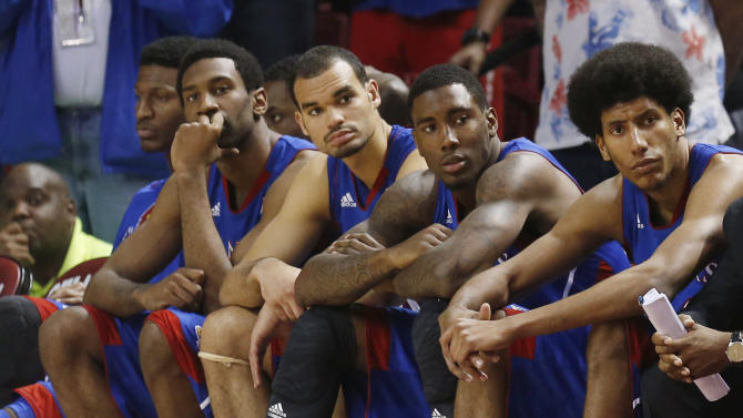 Kansas players watch from the bench in the second half of an NCAA college basketball game against Oklahoma in Norman, Okla., Saturday, Feb. 9, 2013. Oklahoma won 72-66. (AP Photo/Sue Ogrocki)