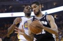 San Antonio Spurs' Duncan takes a rebound from Golden State Warriors' Ezeli during Game 6 of their NBA Western Conference semi final playoff basketball game in Oakland
