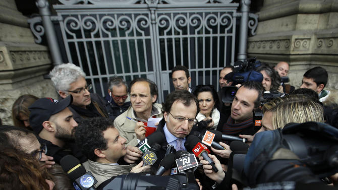 Francesco Maresca, lawyer of Meredith Kercher's relatives, center, is surrounded by journalists as he leaves Italy's Court of Cassation, in Rome, Tuesday, March 26, 2013. Italy's highest criminal court has overturned the acquittal of Amanda Knox in the slaying of her British roommate and ordered a new trial. The Court of Cassation ruled Tuesday that an appeals court in Florence must re-hear the case against the American and her Italian-ex-boyfriend for the murder of 21-year-old Meredith Kercher. (AP Photo/Gregorio Borgia)